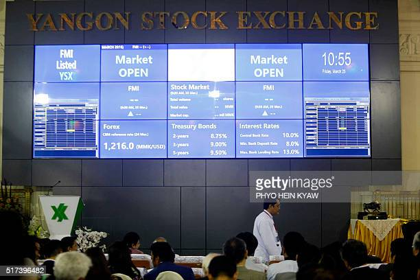 The electronic display board of the newly opened Yangon Stock Exchange housed in a historic building in Yangon shows initial trading on March 25 2016...