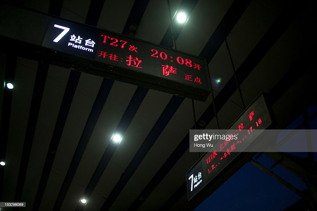 The electronic display board showing the train from Beijing to Lhasa at Beijing Railway Station on August 13, 2012 in Beijing, China. After Qinghai-Tibet Railway went into operation on July 1, 2006, connecting China's capital Beijing and Lhasa of Tibet Autonomous Region by 4,064 km of railway line. Passengers and supplies are transported by train on this the world's highest railway to Tibet.