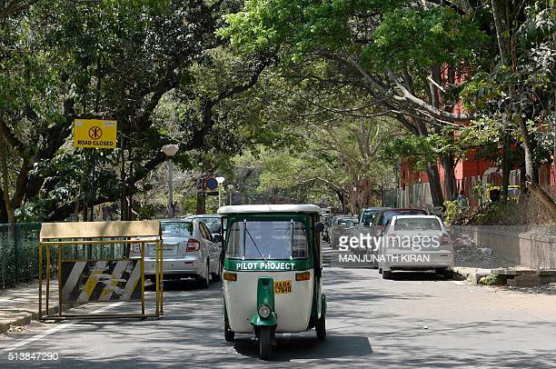 The 'ElericAuto' a solar powered auto rickshaw which runs on electricity stands parked on a street in Bangalore on March 5 2016 The southern Indian...