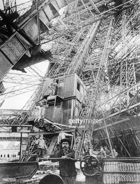 The elevator at the first level of the Eiffel Tower during its construction The elevator is still used for conveying sightseers