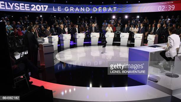TOPSHOT The eleven candidates for the French presidential election attend a debate presented by French TV hosts Ruth Elkrief and Laurence Ferrari and...