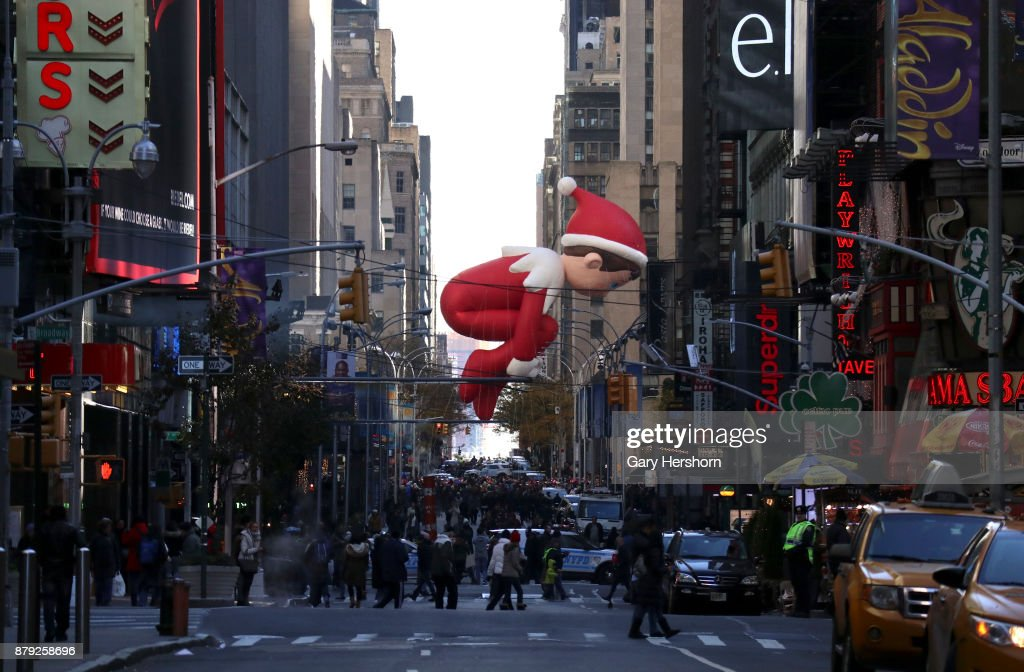 The Elf on a Shelf balloon floats down 6th Avenue as it crosses 49th Street during the annual Thanksgiving Day Parade on November 23, 2017 in New York City. The Macy's Thanksgiving Day parade is the largest parade in the world and has been held since 1924.