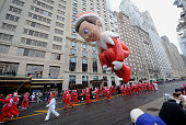 The Elf on the Shelf balloon floats at the 88th Annual Macy's Thanksgiving Day on November 27 2014 in New York City