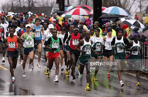 The elite men head down the hill after the start of the 111th Boston Marathon on April 16 2007 in Hopkinton Massachusetts