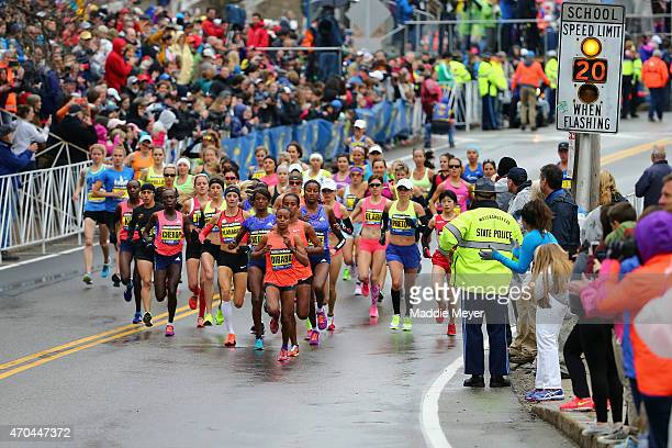 The Elite Women led by Mare Dibaba of Ethiopia begin the 119th Boston Marathon on April 20 2015 in Hopkinton Massachusetts