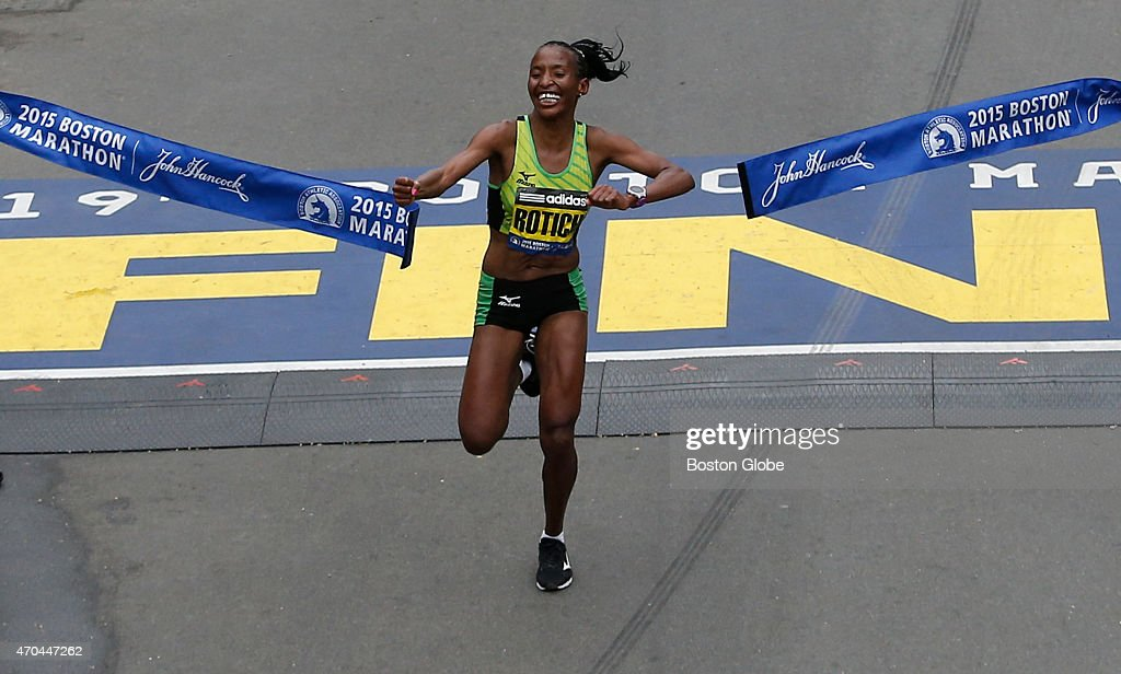 The Elite Womens division winner <a gi-track='captionPersonalityLinkClicked' href=/galleries/search?phrase=Caroline+Rotich&family=editorial&specificpeople=14407354 ng-click='$event.stopPropagation()'>Caroline Rotich</a> crosses the finish line in Boston on April 20, 2015.