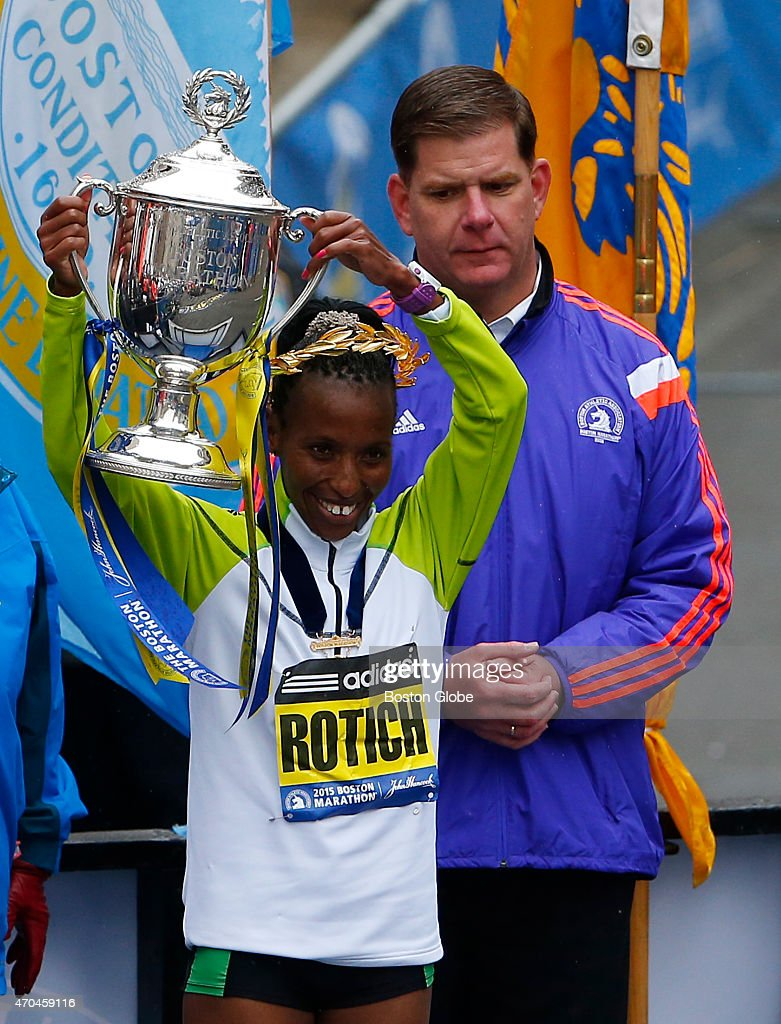 The Elite Womens division winner <a gi-track='captionPersonalityLinkClicked' href=/galleries/search?phrase=Caroline+Rotich&family=editorial&specificpeople=14407354 ng-click='$event.stopPropagation()'>Caroline Rotich</a> hoists the Boston Marathon trophy next to Boston Mayor <a gi-track='captionPersonalityLinkClicked' href=/galleries/search?phrase=Marty+Walsh+-+Politician&family=editorial&specificpeople=2467968 ng-click='$event.stopPropagation()'>Marty Walsh</a> beside the finish line in Boston on April 20, 2015.