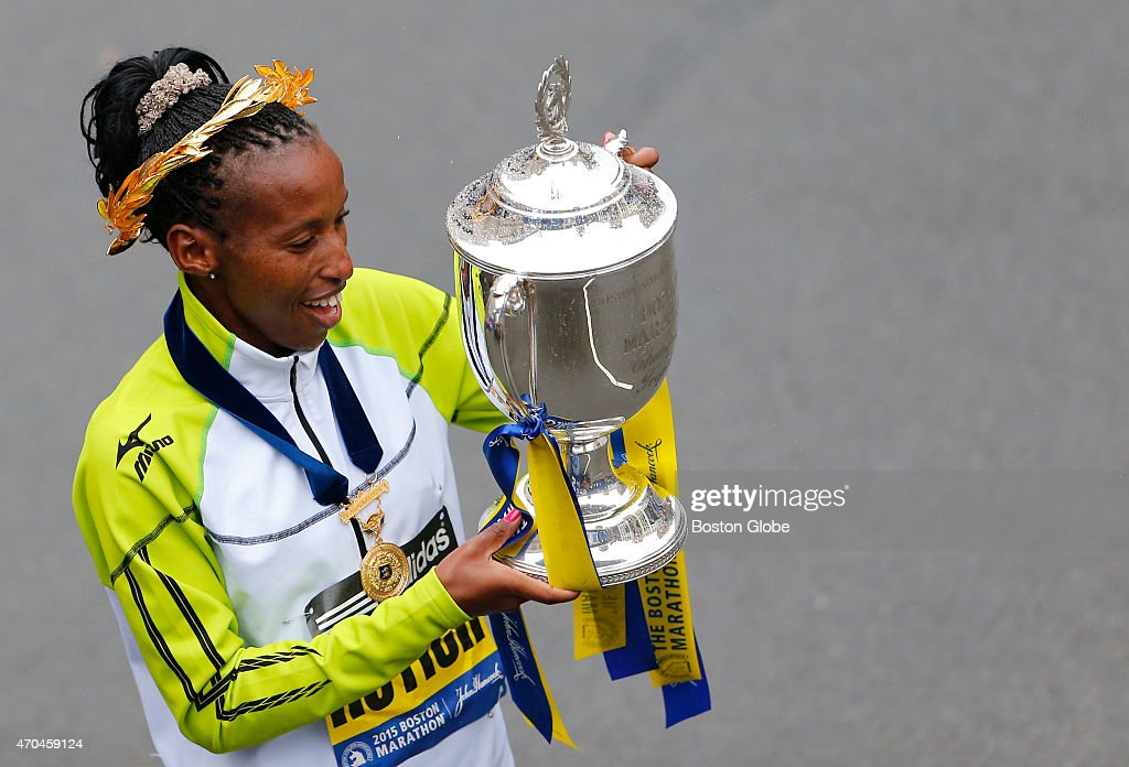 The Elite Womens division winner <a gi-track='captionPersonalityLinkClicked' href=/galleries/search?phrase=Caroline+Rotich&family=editorial&specificpeople=14407354 ng-click='$event.stopPropagation()'>Caroline Rotich</a> hoists the Boston Marathon trophy beside the finish line in Boston on April 20, 2015.