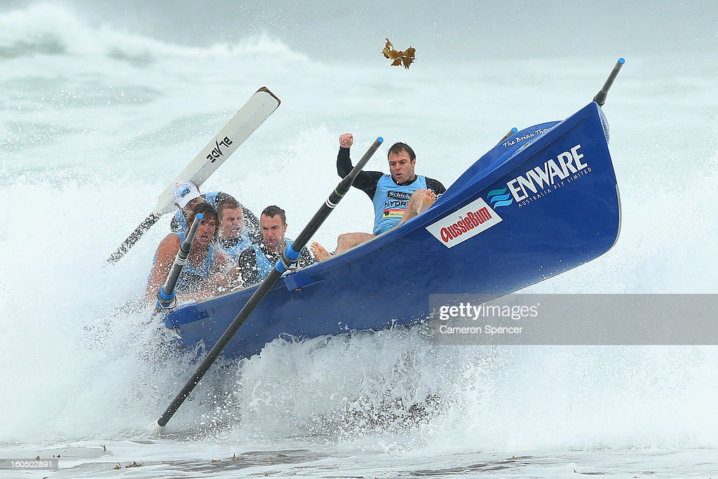 The Elouera Surf Life Saving crew ride a wave during the Ocean Thunder Surf Boat Series at Dee Why Beach on February 2, 2013 in Sydney, Australia.