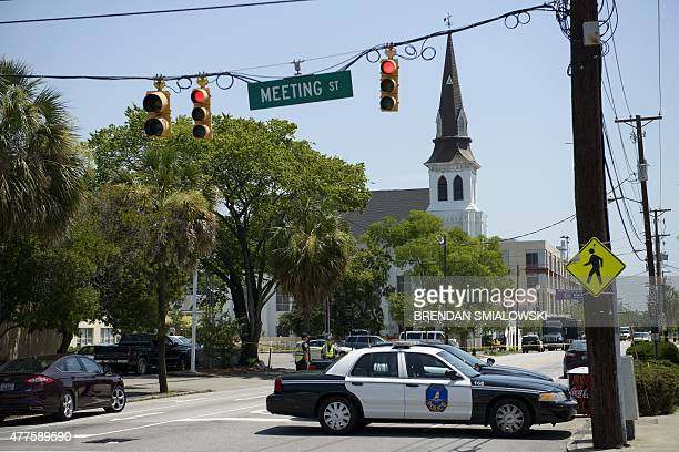 The Emanuel AME Church is viewed behind a police vehicle on June 18 2015 in Charleston South Carolina after a mass shooting at the Church on the...
