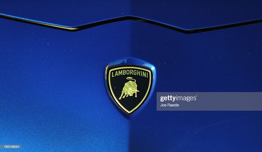 The emblem is seen on the front end of a new Lamborghini Aventador LP700-4 Roadster at the Miami International Airporton January 28, 2013 in Miami, Florida. The world wide unveiling of the new luxury super sports cars took place at the airport.