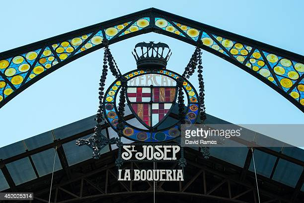 The emblem of Barcelona is seen at the main entrance of 'La Boqueria' green market on July 11 2014 in Barcelona Spain As traders of 'La Boqueria'...