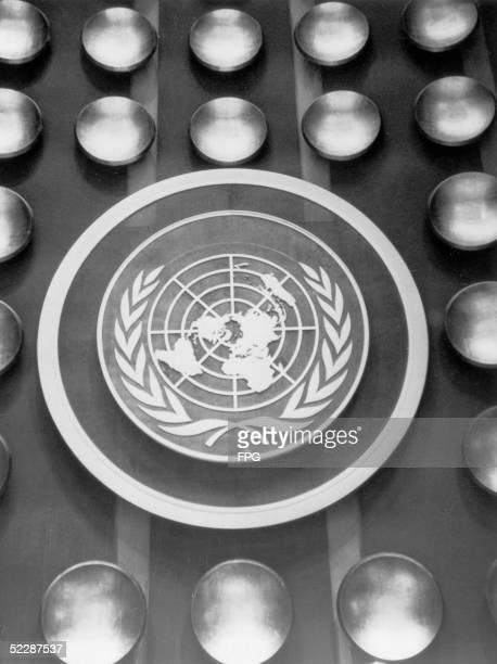 The emblem of the United Nations depicting a map of the world encircled by the olive wreath of peace circa 1950 Dating from 1946 the logo comprises...