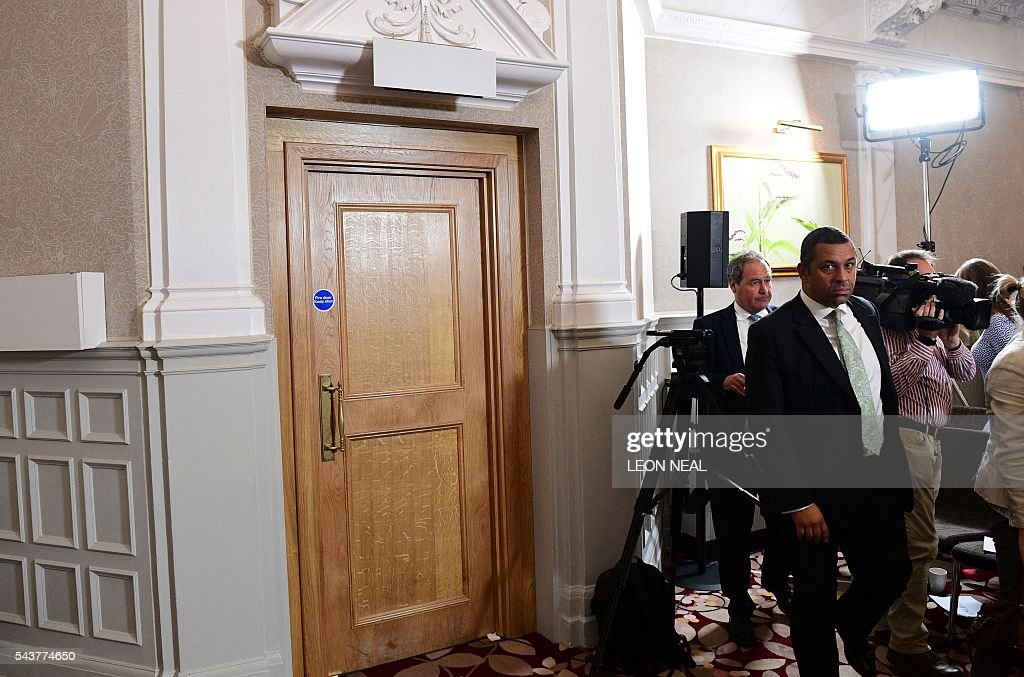 The emergency exit sign (above the door) is covered in a room where Brexit campaigner and former London mayor Boris Johnson addressed a press conference in central London on June 30, 2016. Top Brexit campaigner and former London mayor Boris Johnson said Thursday he will not stand to succeed Prime Minister David Cameron, as had been widely expected after Britain's vote to leave the European Union. / AFP / LEON