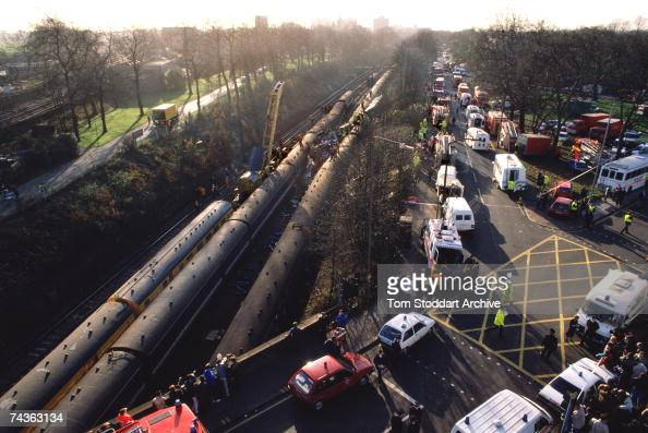 The emergency services attend a rail crash near Clapham Junction in London in which 35 people were killed and over 100 injured December 1988