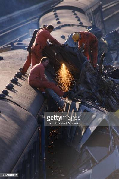 The emergency services cut through derailed carriages to rescue the injured and recover the dead after a rail crash near Clapham Junction in London...