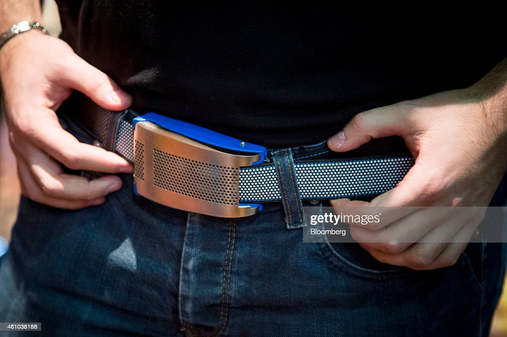 The Emiota smart belt is demonstrated at the CES Unveiled press event ahead of the 2015 Consumer Electronics Show in Las Vegas Nevada US on Sunday...