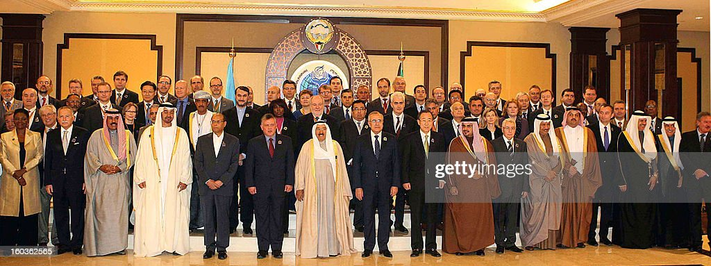 The Emir of Kuwait, Sheikh Sabah al-Ahmad al-Jaber al-Sabah, and UN Secretary General, Ban Ki Moon, pose with Arab leaders and officials in a group photo prior to the opening ceremony of the International Humanitarian Pledging Conference for Syria at the Bayan Palace in Kuwait City on January 30, 2013. Kuwait kicked off the international donors conference for civilians caught up in the Syrian conflict with a pledge of $300 million, as UN chief Ban Ki-moon warned of a 'catastrophic' situation.