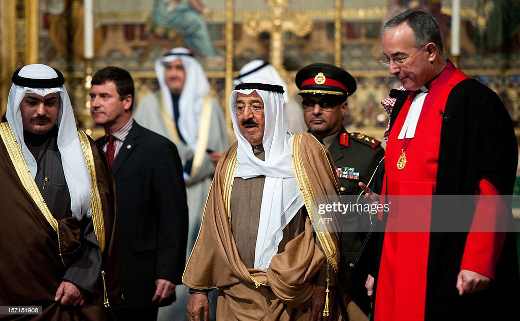 The Emir of Kuwait, Sheikh Sabah al-Ahmad al-Jaber al-Sabah (C), is shown around Westminster Abbey by Dean of Westminster John Hall (R) in London on November 29, 2012. The Emir of Kuwait is on day three of his state visit which is the first from Kuwait to Britain since 1995. AFP PHOTO/WILL OLIVER
