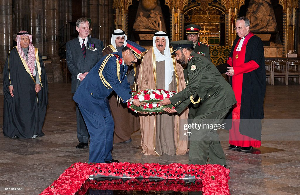 The Emir of Kuwait, Sheikh Sabah al-Ahmad al-Jaber al-Sabah (C), lays a wreath at the tomb of the unknown soldier during a visit to Westminster Abbey in London on November 29, 2012. The Emir of Kuwait is on day three of his state visit which is the first from Kuwait to Britain since 1995.