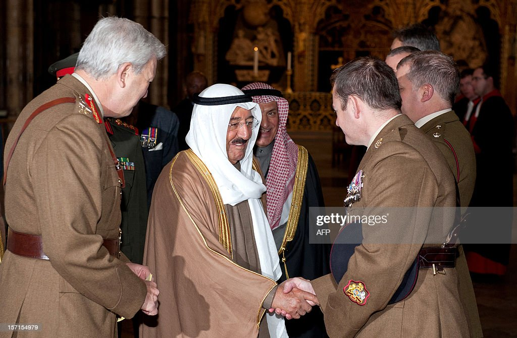 The Emir of Kuwait, Sheikh Sabah al-Ahmad al-Jaber al-Sabah (C), meets members of the British armed forces after laying a wreath at the tomb of the unknown soldier during a visit to Westminster Abbey in London on November 29, 2012. The Emir of Kuwait is on day three of his state visit which is the first from Kuwait to Britain since 1995.
