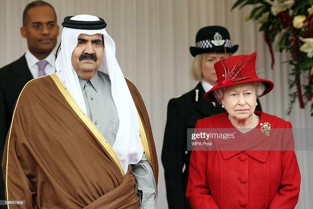 The Emir of Qatar, Sheikh Hamad bin Khalifa al Thani is greeted by Queen <a gi-track='captionPersonalityLinkClicked' href=/galleries/search?phrase=Elizabeth+II&family=editorial&specificpeople=67226 ng-click='$event.stopPropagation()'>Elizabeth II</a> on October 26, 2010 in Windsor, England. The Sheikh is on a two day State visit to the UK, the first since his last in 1985, which is seen as important in strengthening already strongly established business links with one of the Gulf States most financially powerful nations.