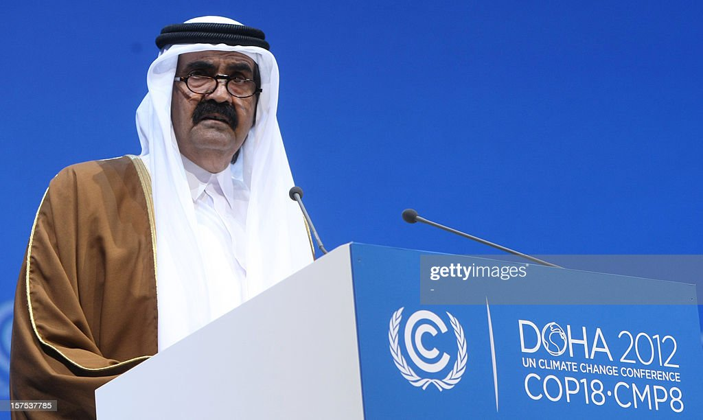 The Emir of Qatar Sheikh Hamad bin Khalifa al-Thani talks during the opening ceremony of Plenary Session of the High-Level Summit of the United Nations Framework Convention on Climate Change (UNFCCC) in Doha on December 4, 2012. AFP PHOTO/STR