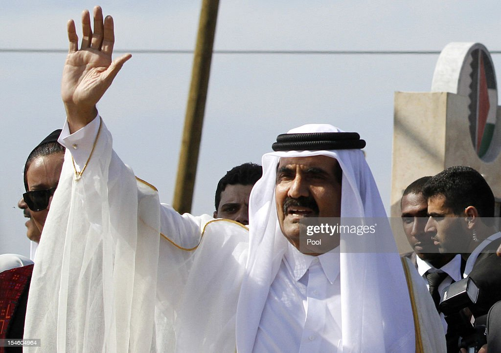 The Emir of Qatar Sheikh Hamad bin Khalifa al-Thani waves to the crowd as they arrive to a cornerstone-laying ceremony of a Qatari funded rehabilitation center October 23, 2012 in Gaza City, Gaza. The Emir of Qatar received a hero's welcome in Gaza, becoming the first head of state to visit the Palestinian territory since the Islamist militant Hamas seized control there in 2007.