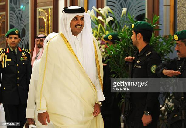 The Emir of Qatar Sheikh Tamim bin Hamad alThani attends a Gulf Cooperation Council informal summit in the Saudi Red Sea city of Jeddah on May 31...