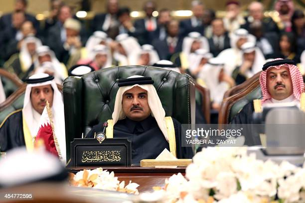 The Emir of Qatar Sheikh Tamim bin Hamad bin Khalifa alThani attends the 34th summit of the Gulf Cooperation Council at the Bayan Royal Palace in...