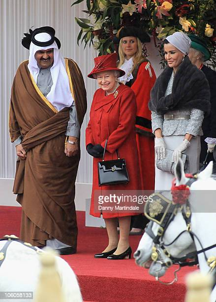 The Emir of the State of Qatar Sheikh Hamad bin Khalifa al Thani and Sheikha Mozah Bint Nasser AlMissned are greeted by Queen Elizabeth II on their...