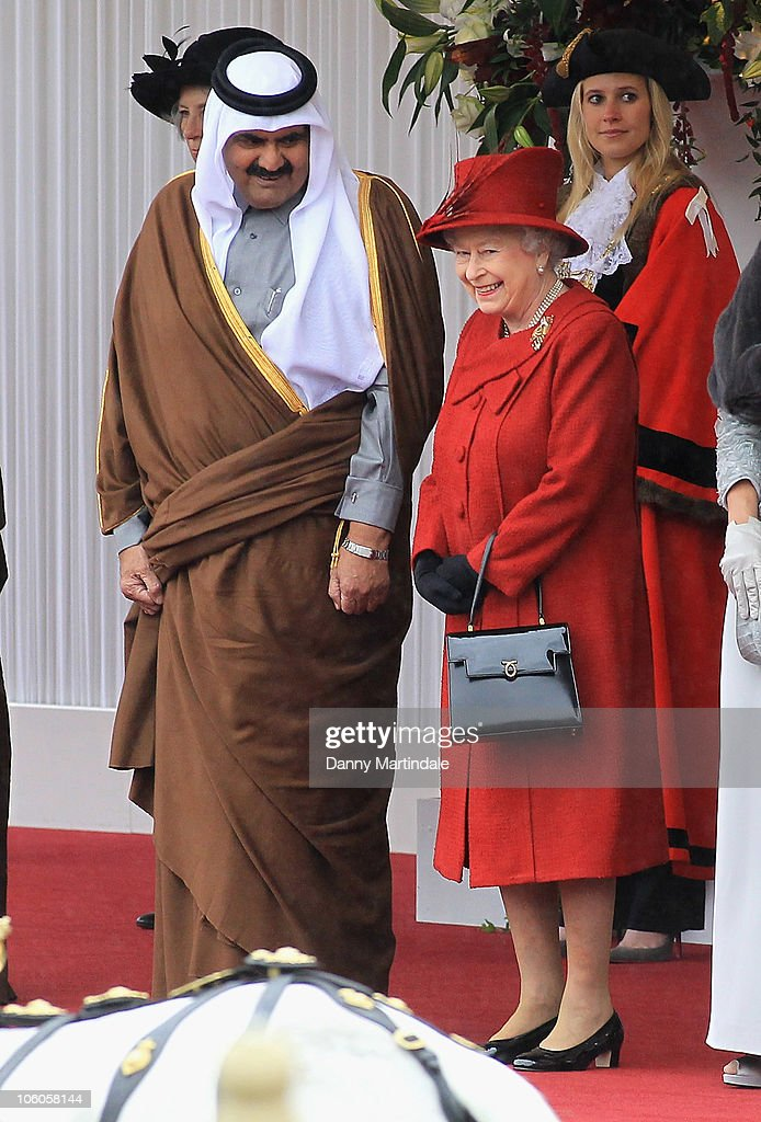 The Emir of the State of Qatar, Sheikh Hamad bin Khalifa al Thani is greeted by Queen <a gi-track='captionPersonalityLinkClicked' href=/galleries/search?phrase=Elizabeth+II&family=editorial&specificpeople=67226 ng-click='$event.stopPropagation()'>Elizabeth II</a> on state visit to Windsor Castle on October 26, 2010 in Windsor, England.