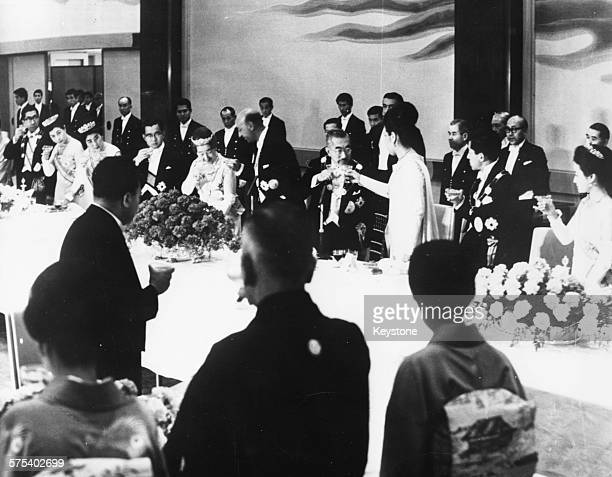 The Emperor and Empress of Japan toasting with King Mohammed Zahir Shah at a state banquet in the Imperial Palace Tokyo April 14th 1969