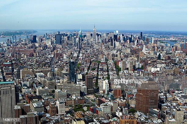 The Empire State Building and lower Manhattan can be seen from the 90th story of One World Trade Center on April 30 2012 in New York City One World...