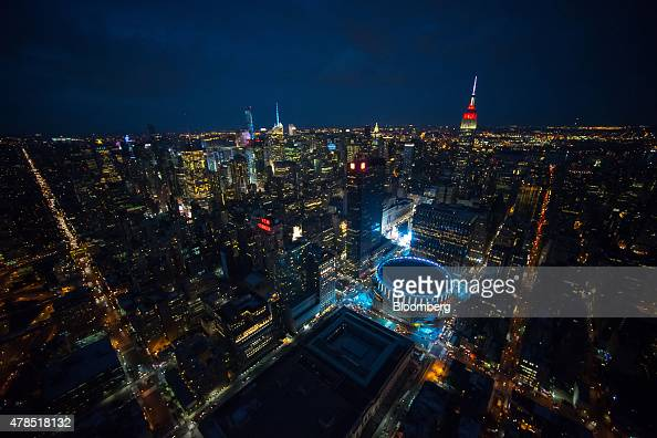 The Empire State Building and Madison Square Garden stand in the Manhattan skyline at dusk in this aerial photograph taken above New York US on...