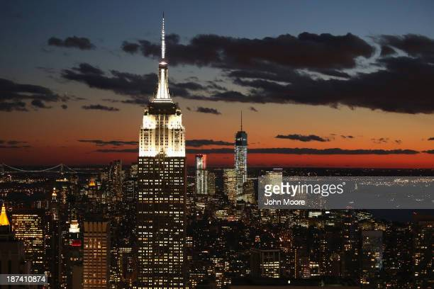The Empire State Building and One World Trade Center tower over Manhattan on November 8 2013 in New York United States The Council on Tall Buildings...