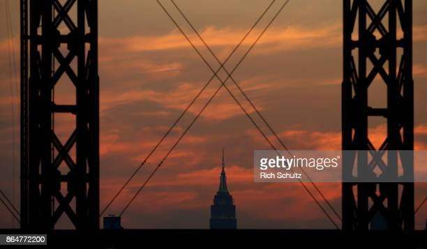The Empire State Building as seen under the light towers as the sun sets during the first game of a double header between the Atlanta Braves and New...