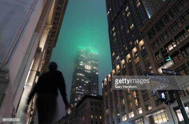 The Empire State Building glows in green in the fog for World Environment Day on February 8 2017 in New York City