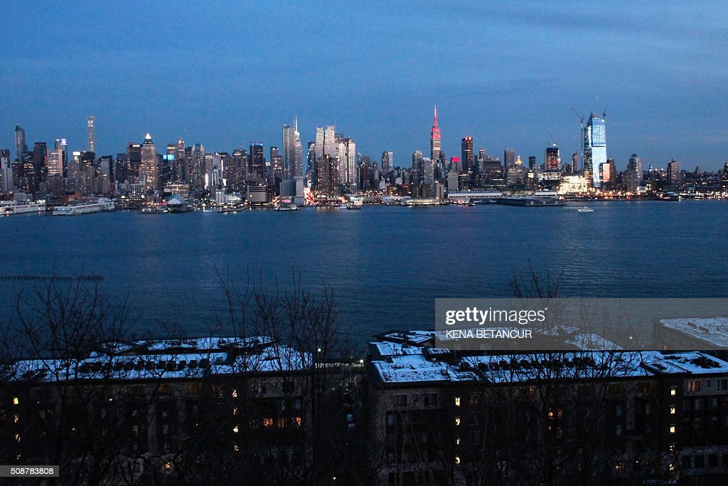 The Empire State Building in New York City is lit in red and gold in honor of the Chinese Lunar New Year, aas seenfrom Weehawken, New Jersey, on February 6, 2016. BETANCUR