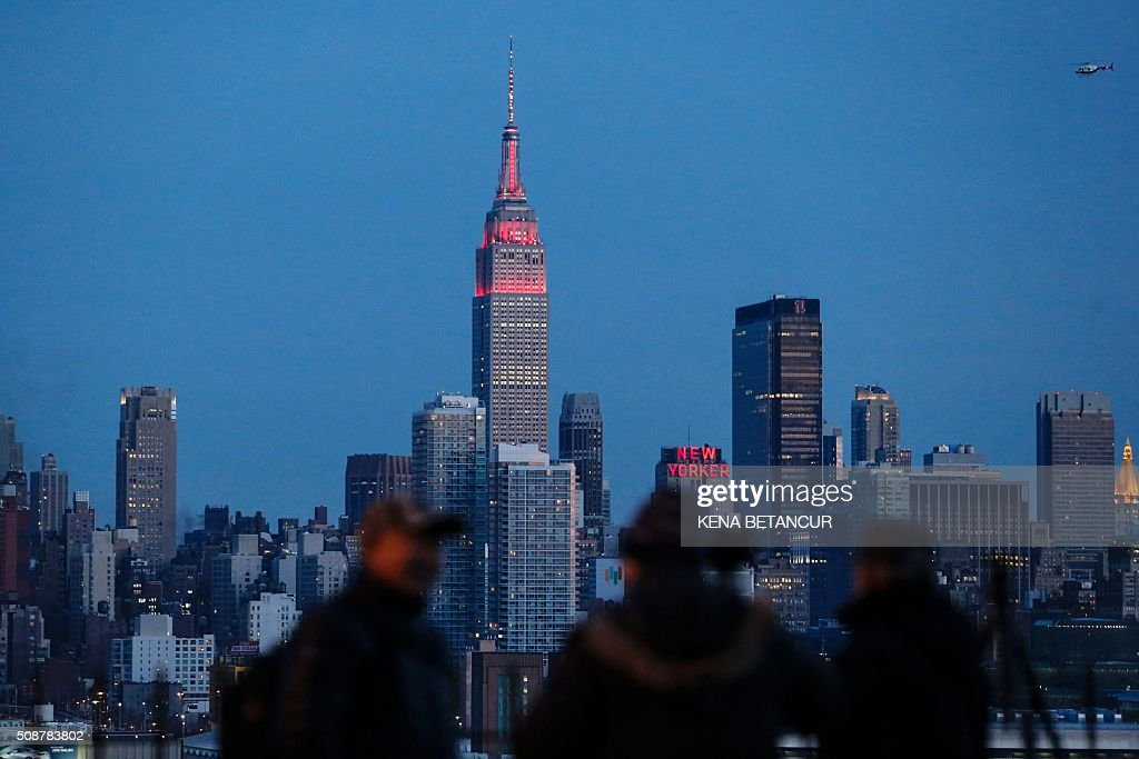 The Empire State Building in New York City is lit eed and gold in honor of the Chinese Lunar New Year, aas seenfrom Weehawken, New Jersey, on February 6, 2016. BETANCUR