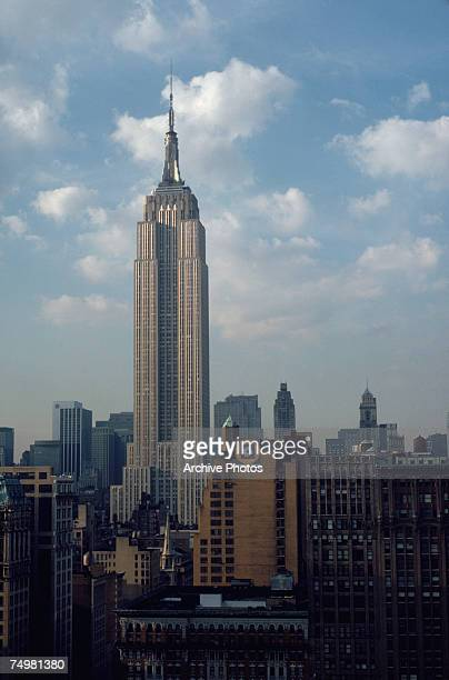 The Empire State Building in New York City with the J J Newberry Co logo in front of it circa 1970