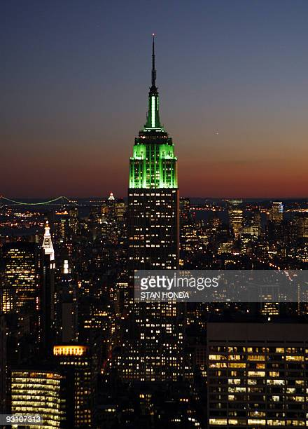 The Empire State Building is illuminated with green lights at sunset in honor of the Muslim holiday EidalFitr marking the end of Ramadan 12 October...
