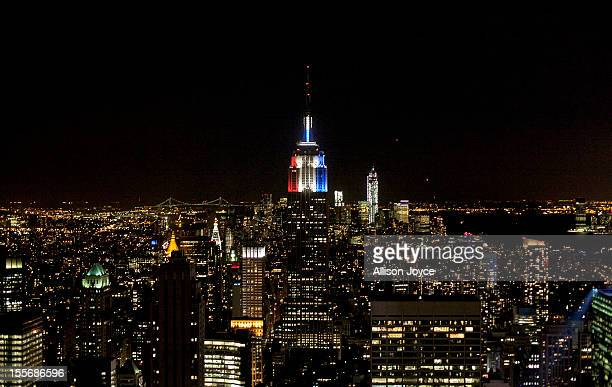 The Empire State Building is lit red white and blue for election night November 6 2012 in New York City Voters went to polls in the heavily contested...