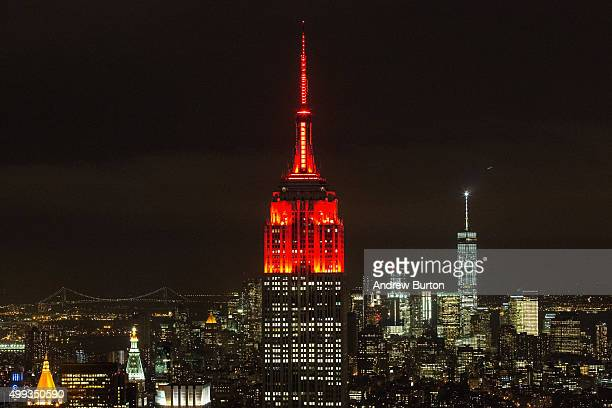 The Empire State building is lit with red lights in honor of World Aids Day on November 30 2015 in New York City The annual event is observed...