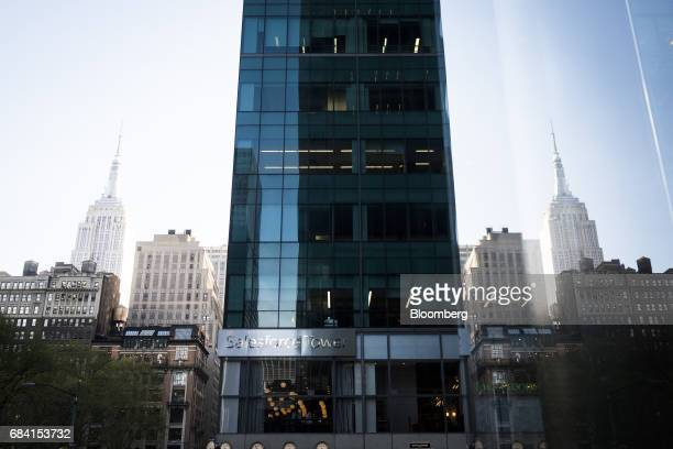 The Empire State Building is reflected in a window next to the Salesforce Tower in New York US on Friday April 28 2017 Salesforcecom Inc is scheduled...