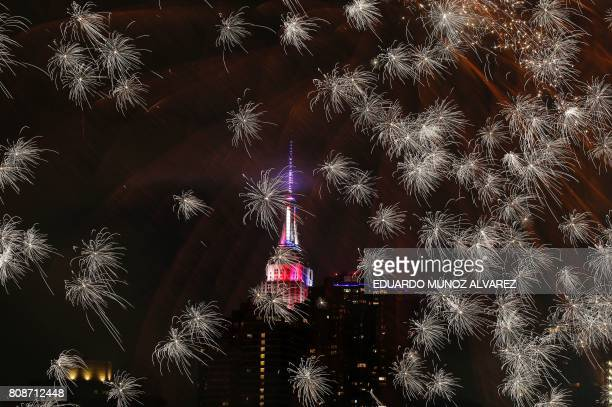 TOPSHOT The Empire state Building is seen during the Macy's 4th of July fireworks show from Queens New York on July 4 2017 / AFP PHOTO / EDUARDO...
