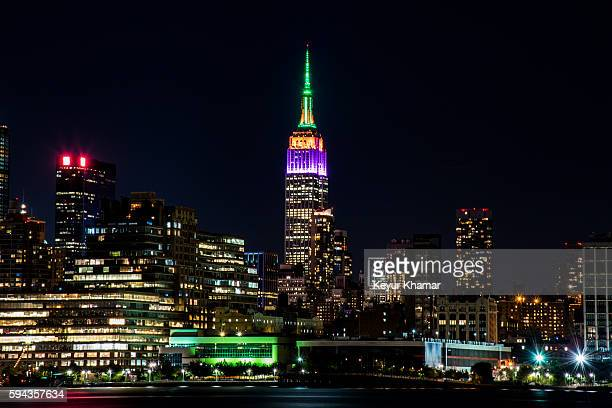 The Empire State Building is seen lit in the colors of FedEx Corp prior to the start of The Barclays and the FedExCup Playoffs on August 22 2016 in...