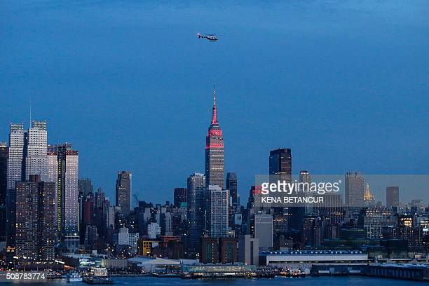 The Empire State Building light up in red and gold in honor of the Chinese lunar new year and the skyline of New York from Weehawken New Jersey on...