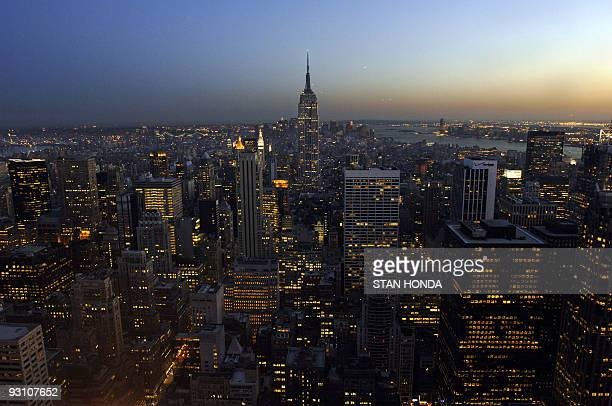 The Empire State Building rises out of the Manhattan skyline at twilight 28 April 2006 in New York 01 May 2006 marks the 75th anniversary of the...
