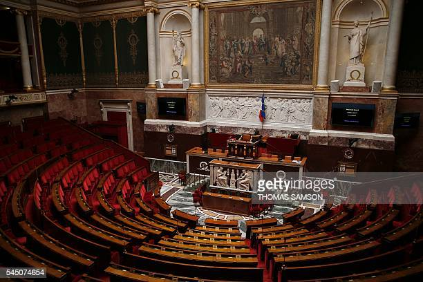 TOPSHOT The empty assembly room of the French National Assembly is pictured prior to a debate on the government's planned labour law reforms on July...
